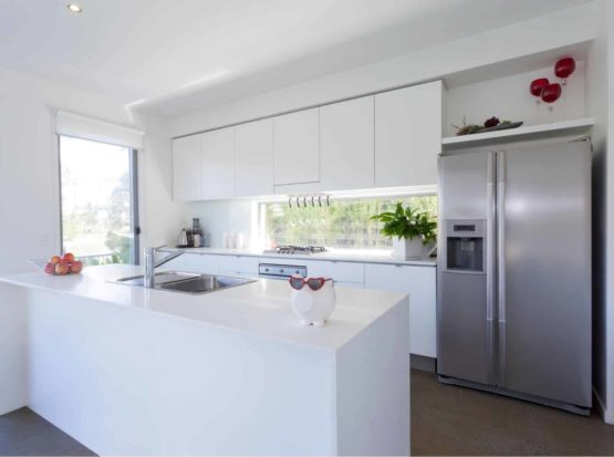 New Kitchen with silver appliances and white marble top in Chatswood